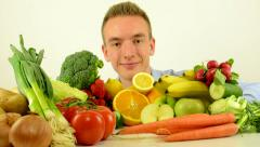 Stock Video Footage of man smiles - healthy food - vegetables and fruits - white background studio