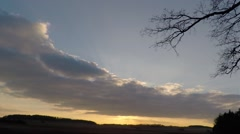 Time Lapse, Sunset with clouds heading towards the sun Stock Footage