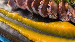 Meat meal decorated with sauce and prepared by professional chef Stock Footage