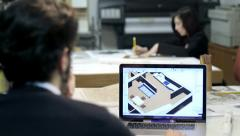 Architect studio: male and female architect at work: cad software, blueprint Stock Footage