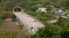 Traffic on the highway exiting from mountain tunnel, with sound Stock Footage