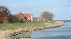 Houses behind dike in Holland Stock Footage