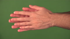 4K Man Rubs Hands Together Close Up Green Screen - stock footage