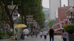 Orchard road -opposite direction people walking Stock Footage