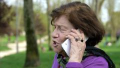 Happy old woman on the cell phone talking to his son Stock Footage
