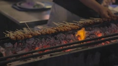 Satay sticks being cooked on charcol Stock Footage