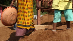 Legs of women and children in soil at field in Goa. Stock Footage