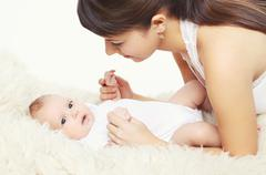 Portrait of cute baby with young mom at home, comfort Stock Photos