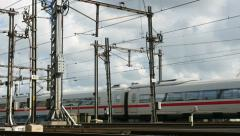 Silver train leaving city Stock Footage
