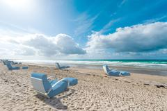 Relaxing seats on the beach - stock illustration