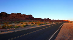Long and lonesome road through the desert of Arizona Stock Footage