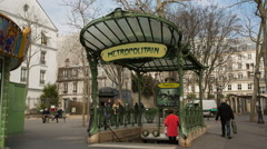 Stock Video Footage of Abbesses metro station in Paris with people passing by and entering