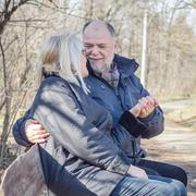 Happy Elderly Senior Romantic Couple Relaxing in the nature. Old people sitti - stock photo