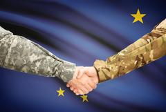 Stock Illustration of Soldiers handshake and US state flag - Alaska