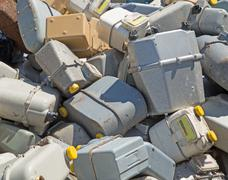 Bunch of old gas meters in a contaneir of the landfill Stock Photos