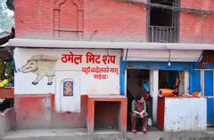 Nepalese women sell pig at Butcher Shop or fresh pork market at Thamel Maket Stock Photos