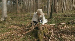 Female Shaman executing magical ritual in forest Stock Footage