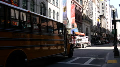 School bus passing by the paramount theater in Boston Stock Footage