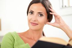 Head and shoulders portrait of a beautiful caucasian woman looking at camera Stock Photos