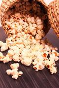 popcorn spread on wooden base - stock photo