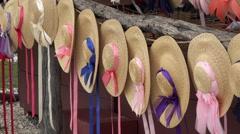 Colonial Williamsburg Virginia historic woman straw hats 4K 038 Stock Footage