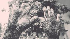 designing mehandi showing by hands up - retro look - stock photo
