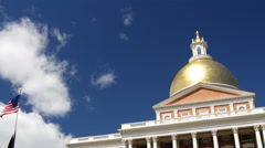 Massachusetts State House with American flag Stock Footage