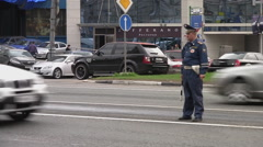 RUSSIA. MOSCOW. MAY 2009: Russian policeman looks at passing cars. day Stock Footage