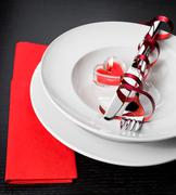 Valentine day dinner with table setting in red and elegant heart ornaments Stock Photos