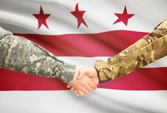 Stock Illustration of Soldiers handshake and US state flag - District of Columbia