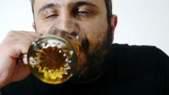 Young man drinking beer Stock Footage