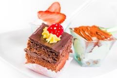 Delicious slice of chocolate cake with cream and candy to sugar - stock photo