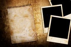 old used notebook on grunge background with photo frame - stock illustration