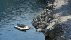 Yosemite Hetch Hetch Dam 96fps 02 Slow Motion boat by shore Stock Footage