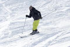 Athlete skiing in the snowy mountains - stock photo