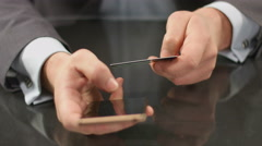 Boss using mobile banking on smartphone, inserting card number Stock Footage