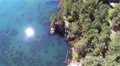 Reflection of  sun in blue water of  canyon lake. Aerial  POV  HD Footage
