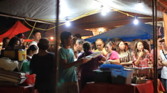 People Order Food at Chamorro Village Market at Night on GUAM, USA - stock footage