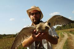 Hunter with a bittern. Altai Stock Photos