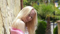 Joyful blond lady and beautiful artistic wall. - stock footage