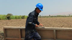 Stock Video Footage of Contruction Workers at Work, Building , Digging and Working in Rural Town