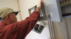 Electrician Fixes a Electical Box on Guam Stock Footage