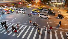 Road intersection top view, regulator controls traffic flow, Taipei 101 - stock footage