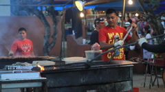 Man Grills Meat at the Chamarro Village Night Market GUAM, USA Stock Footage