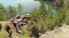 Tourists on the banks of the flooded quarry. Aerial view Stock Footage