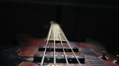 Bass guitar string vibrating. Close up. Black background. Stock Footage
