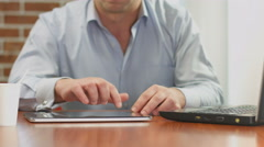 Freelance worker hands typing, sending e-mail from tablet PC Stock Footage