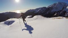 Hunter tramping on snowy mountain aerial. Stock Footage