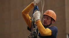 Industrial climber climbing rope. Facade Cleaning. HD1080p. Mountaineering gear Stock Footage