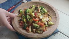 vegetable ragout on wooden plate - stock footage